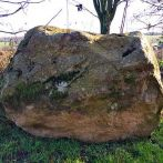 Recumbent boulder stone.  Seat stone wonderfully weathered