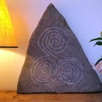 "Pyramid shaped river washed limestone from the River Tees, Co Durham. Hand carved with the Celtic triple spiral design. Dimensions: 2ft x 2ft x 6"". Suitable for interior and exterior use."
