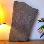 "River washed limestone from the River Tees Co Durham. Hand carved with a Bronze Age labyrinth design. Size: 2ft x 14"" x 4"". Suitable for interior or exterior use."