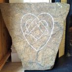 River washed limestone with hand carved Celtic heart symbol