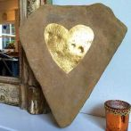 River washed limestone with hand carved heart in gold leaf