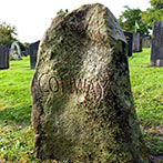 Rugged sarsen stone natural headstone with a hand carved inscription
