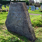 Limestone headstone with a hand carved inscription