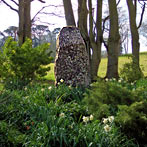 Brooding garden monolith beautifully positioned in woodland