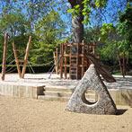 Holed stone as an alternative play element in a natural play area